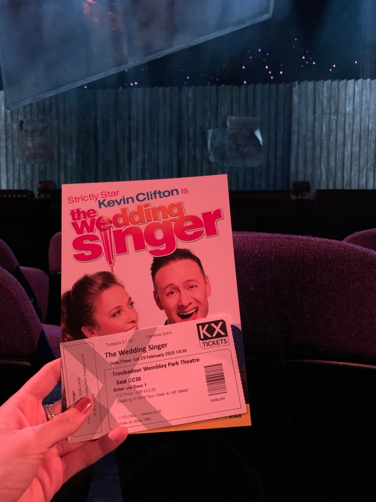 "Display of a theatre ticket and a leaflet of a London show ""The Wedding Singer""."