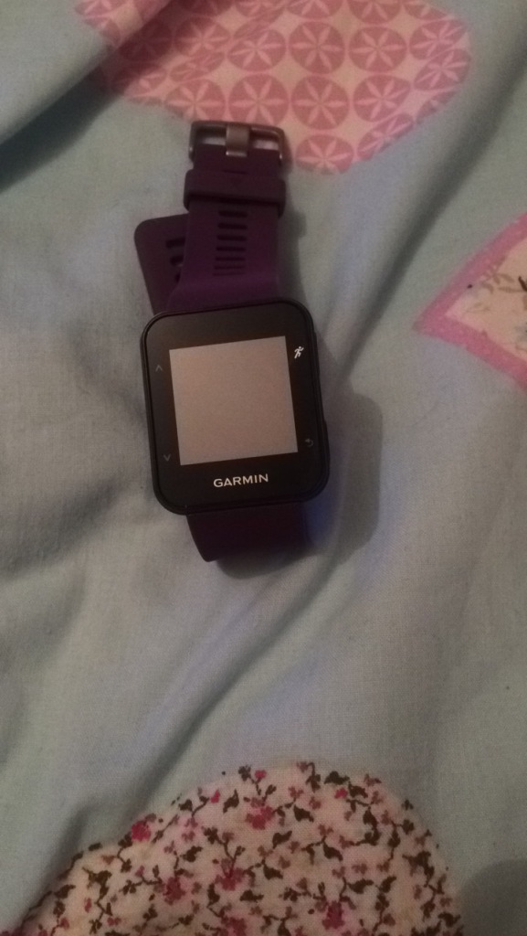 A purple Garmin watch from the front view.