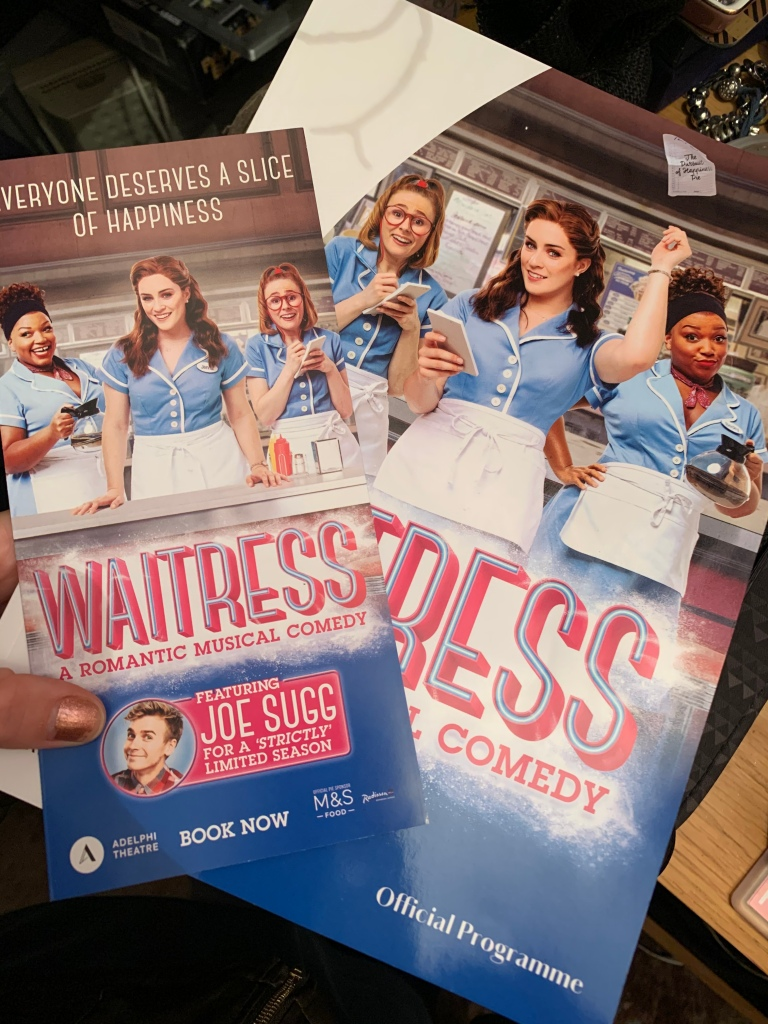 "A leaflet and booklet of the musical ""Waitress"" in London."