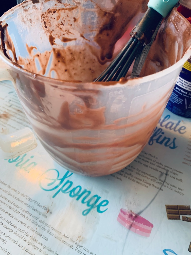 A mixing bowl filled with chocolate mix.