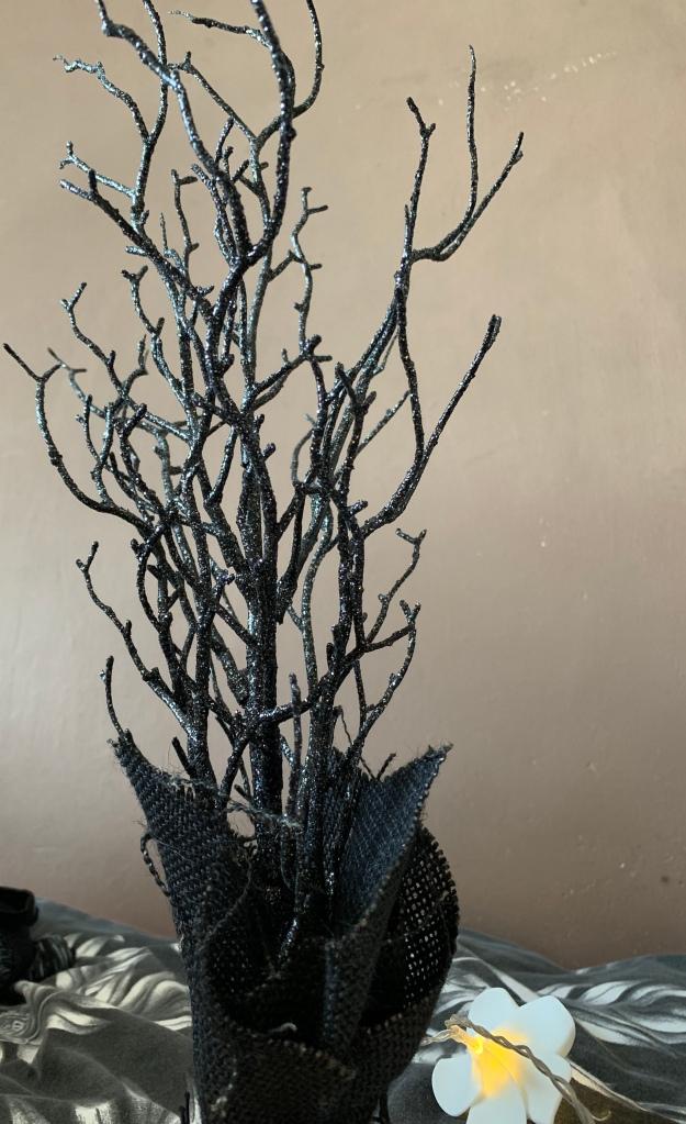 A black sparkly tree for Halloween decor.