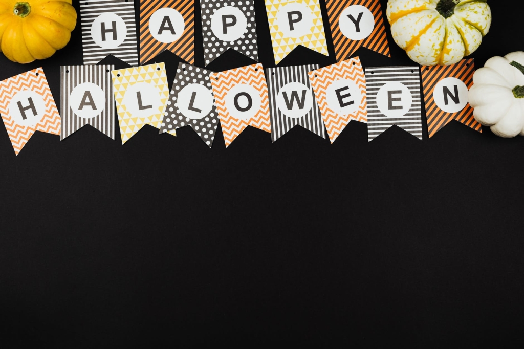 A banner that says happy Halloween in individual letters