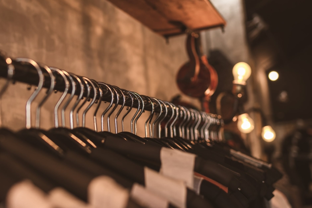 A selection of clothes displayed as only the tops of the hangers